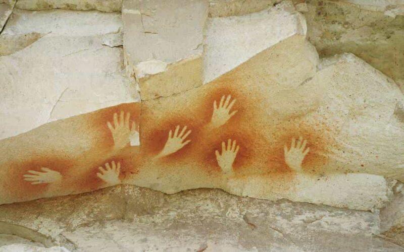 Symbolbild: Symbole. Handabdrücke, Höhlenmalerei.